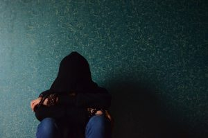 adult alone backlit dark